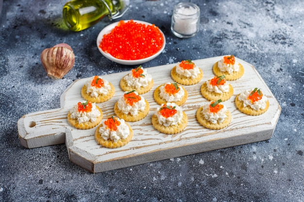 Canape with red caviar for party