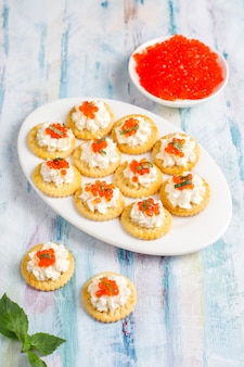 Canape with red caviar for party.