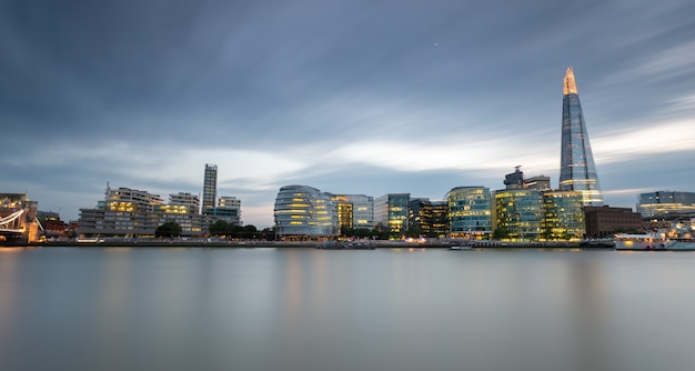 Canary wharf harbour at blue hour after sunset in london