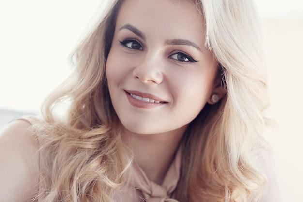 Candid beautiful blonde woman portrait