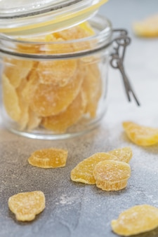 Candied ginger slices. sweet spicy treat for tea. prevention of colds. health