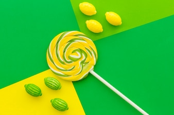 Candies and lollipop on contract colored paper background