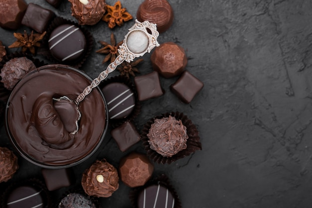 Candies and melted chocolate with copy space