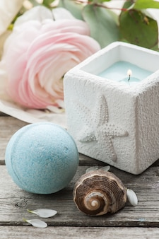 Candle and blue bath bomb