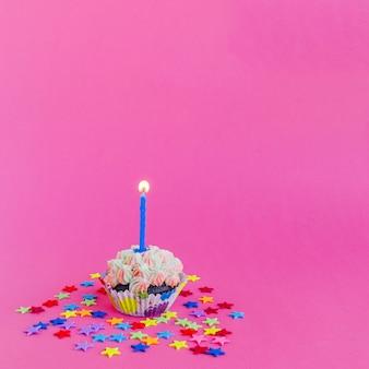 Candle burning in cupcake