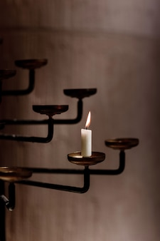 Candle burns in the rustic candlestick. candle in church