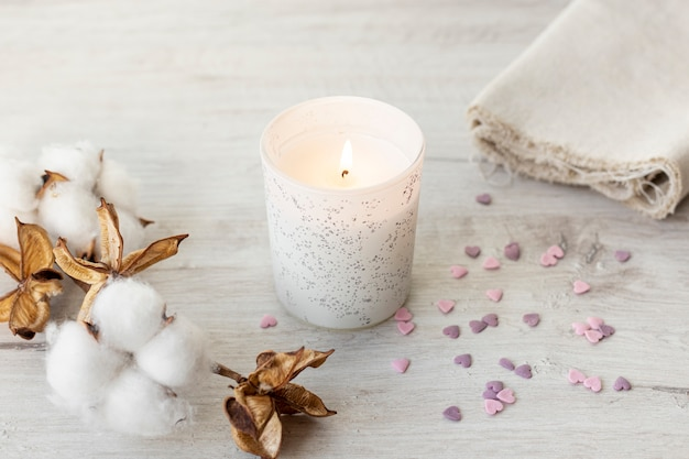 Candle and cotton flowers for valentines day