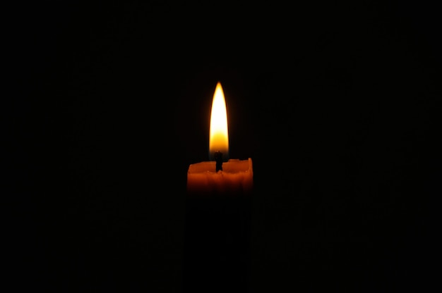 Candle on a dark background.