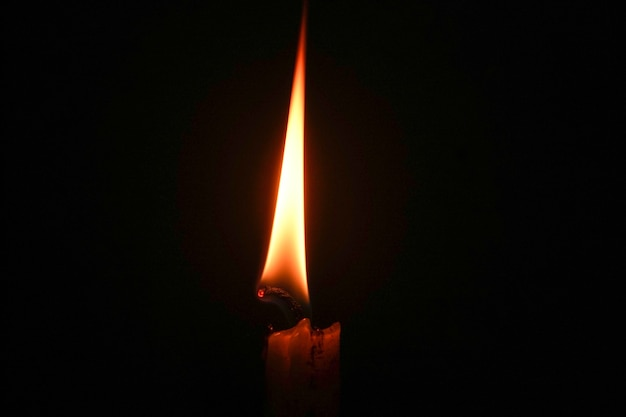 Candle flame close up on a black background light source on dark background