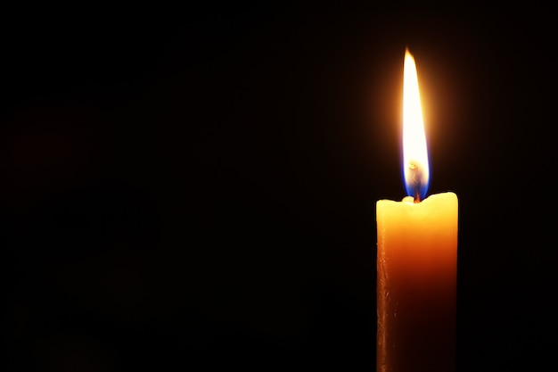 Candle flame isolated on black
