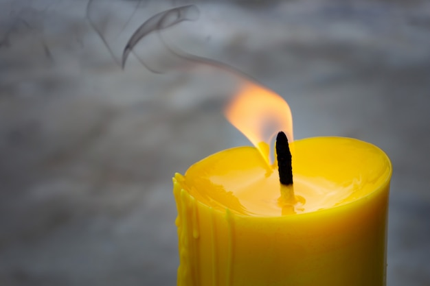 A candle is an ignitable wick embedded in wax