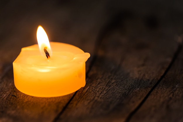 Candle light glowing on wooden table
