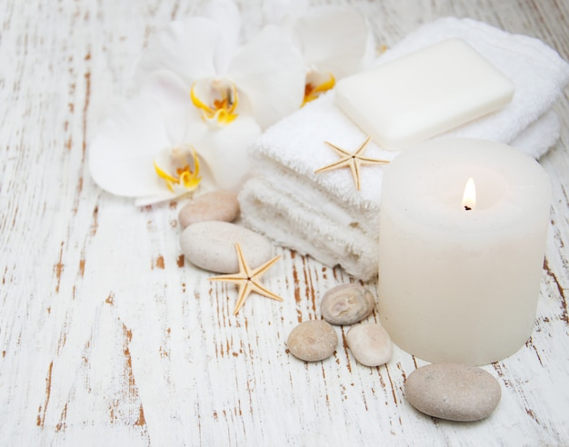 Candle, orchids and towels