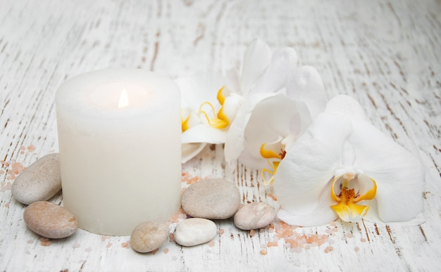 Candle, orcids and stones