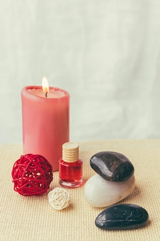 Candle, stones and lotion