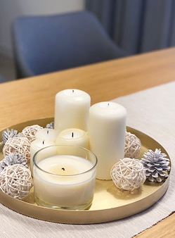 Candle tray with winter christmas decor on table
