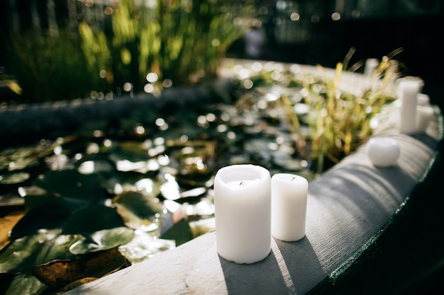 Candlelight decoration at a wedding ceremony in a summer garden near a fountain
