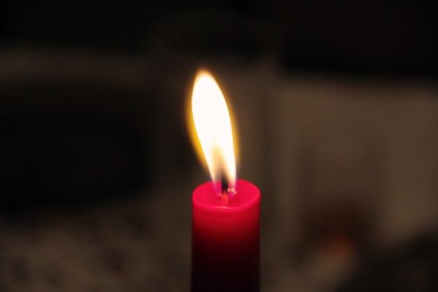 Candlelight shadow burning red candle illuminated