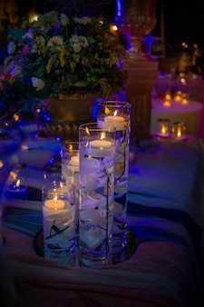 Candles floating in glass flasks