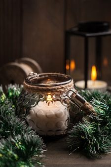 Candles in lanterns and christmas decoration