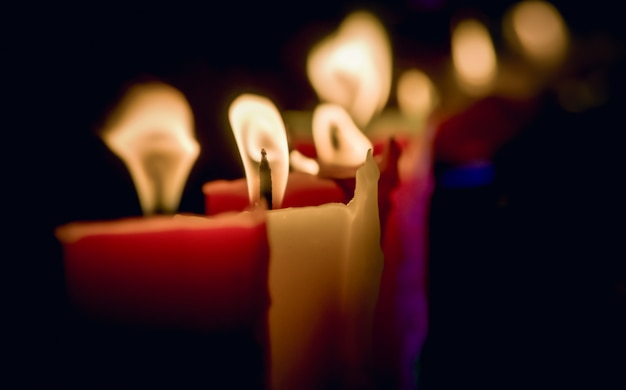 Candles light at night, abstract glowing background