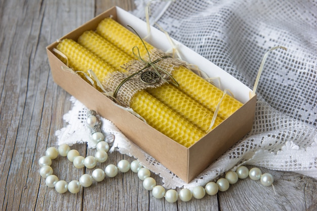 Candles made of natural wax, in a wooden box, made for the holiday. the candle is made of honeycomb.