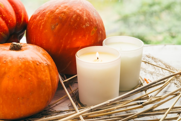 Candles and pumpkins on table
