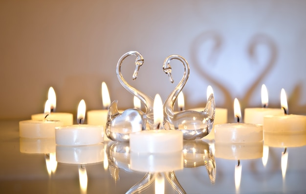 Candles in the shape of a heart with swans