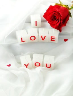 Candles with printed sign i love you,on white fabric