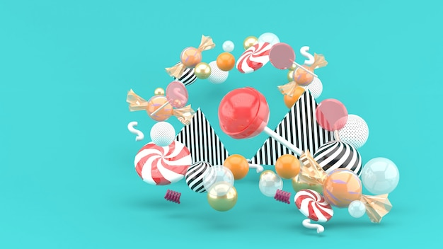 Candy among colorful balls on blue. 3d rendering.