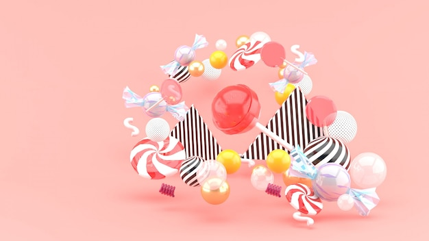 Candy among colorful balls on pink. 3d rendering.