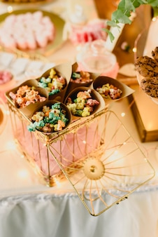 Candy bar beautifully decorated with sweets in a vintage event