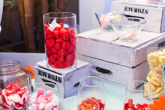 Candy bar. delicious sweet buffet with cupcakes and jelly beans