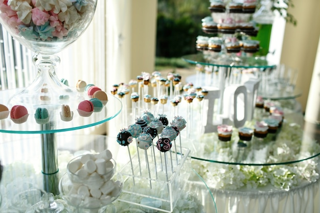 Candy bar made of tired glass dishes decorated