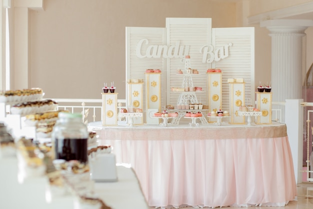 Candy bar. sweet holiday buffet with cupcakes and other desserts.