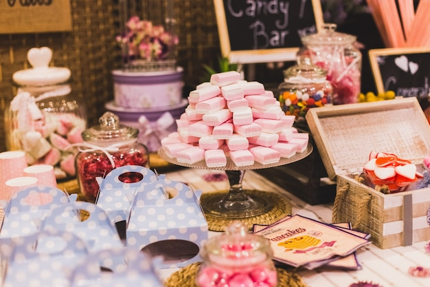 Candy bar at a wedding filled with sweets and baubles