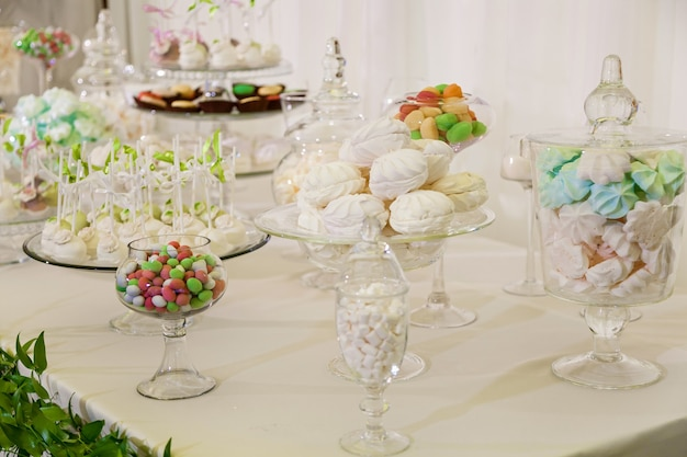 Candy bar for a wedding party colorful table with sweets for the wedding