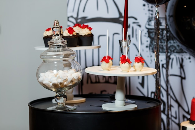 Candy bar on womans birthday party with cakes