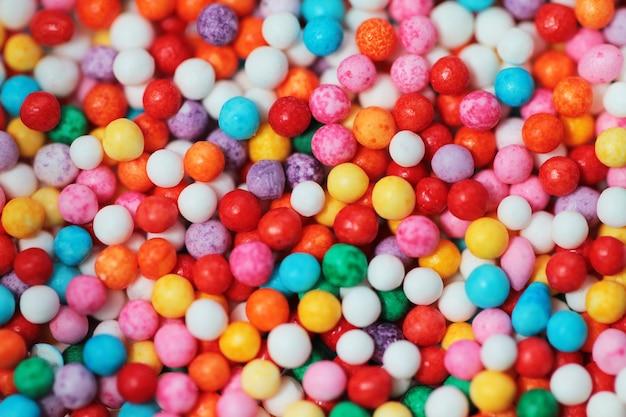 キャンディの明るい背景は食べ物の写真をクローズアップ
