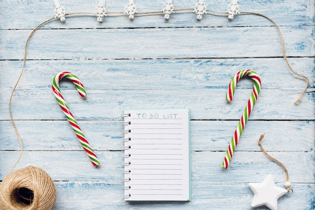 Candy cane and to do list on blue and white