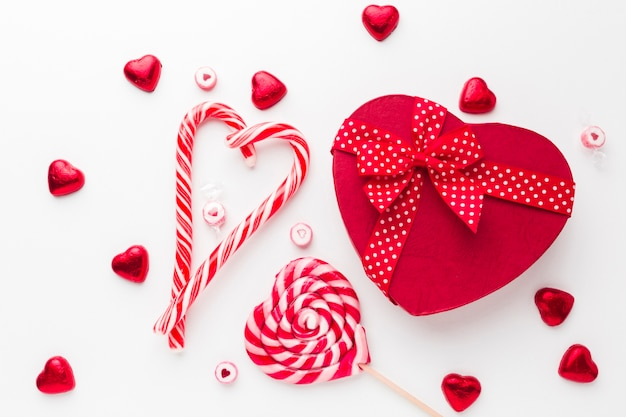 Candy cane lollipop and a heart shaped box