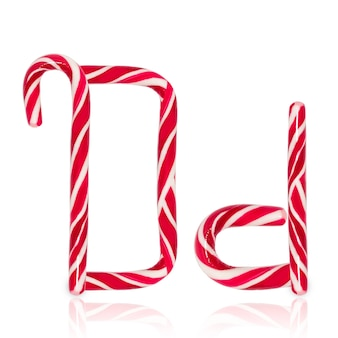 Candy cane in shape of letter d isolated