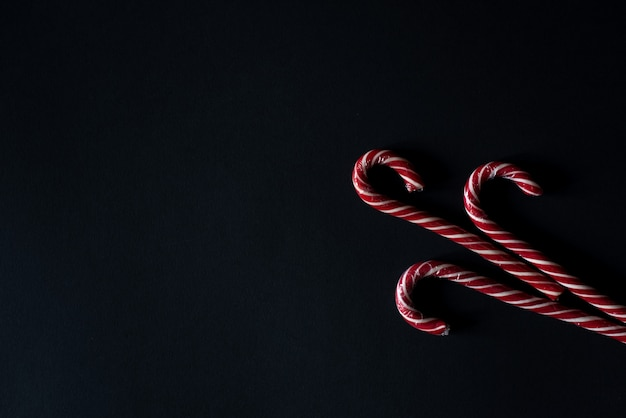 Candy canes on gray stone background. close up