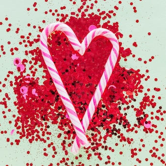 Candy canes in heart shape on spangles