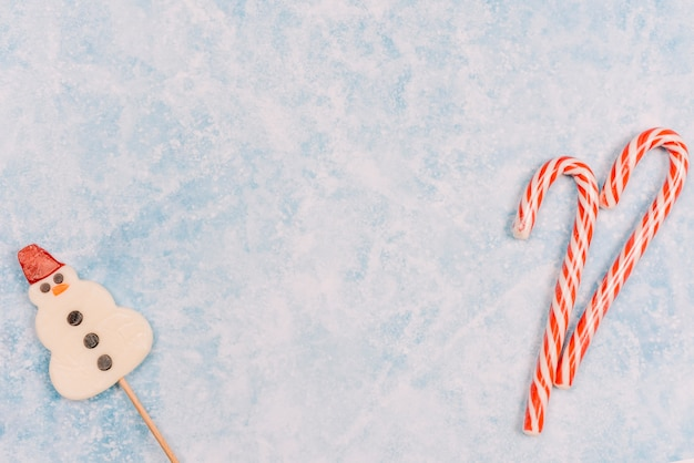 Candy canes and snowman shaped lollipop