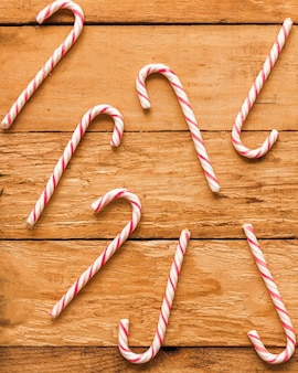 Candy canes on wood board