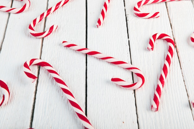 Candy canes on wood desk