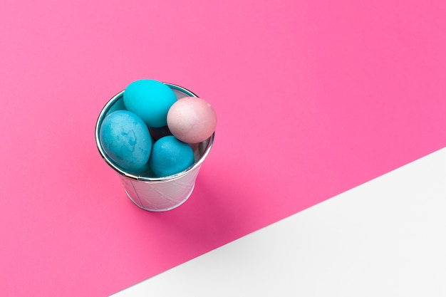 Candy color easter eggs over bright paper
