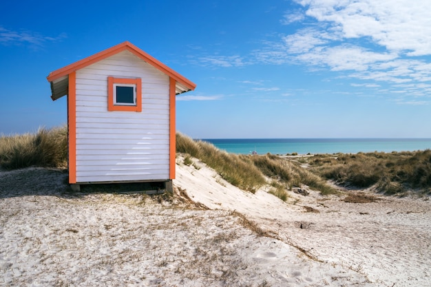 Candy coloured beach hut on skanor beach in falsterbo, skane, sweden. swedish tourism concept