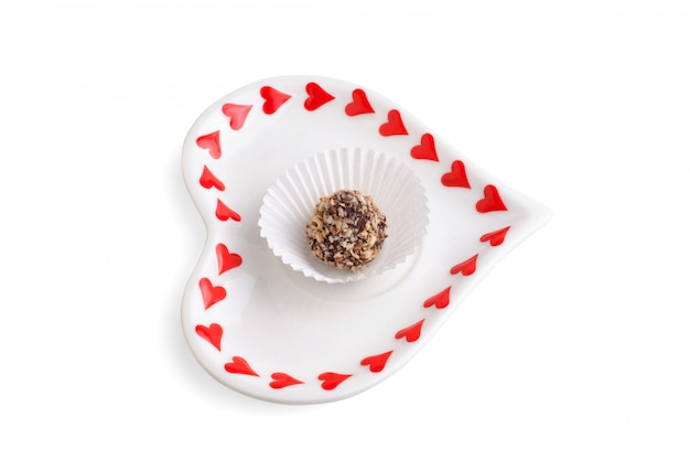 Candy on the saucer isolated